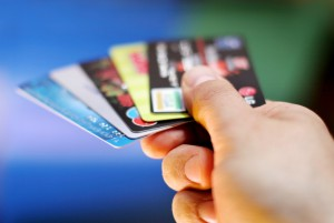 Paying more than the minimum monthly payments on your credit cards and only using them for certain purchase are ways to lower your credit card debt.